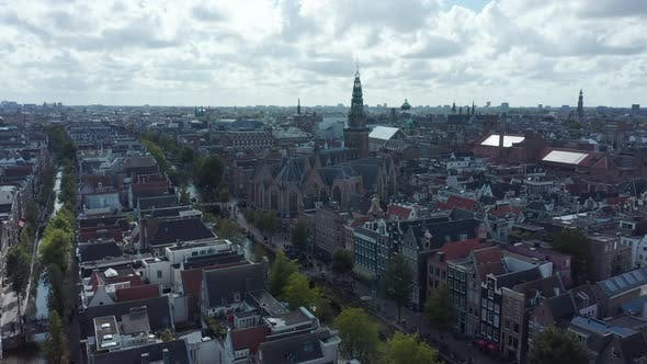 Thumbnail for Amsterdam Cityscape with Canals From Drone Perspective with Clouds