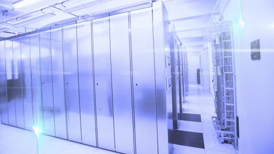 Computer servers in a server room with glowing lights