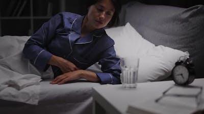 Woman Drinking Water at Night