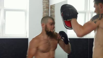 Professional Mma Fighters Practicing at Sports Club