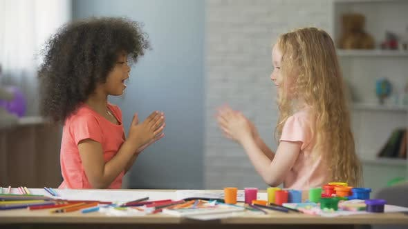 Thumbnail for Positive Afro-American and Caucasian Girls Clapping Hands, Happy Childhood