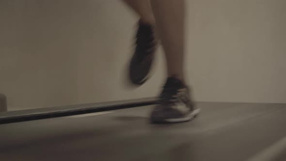 Thumbnail for Male Caucasian Feet in Sneakers Running on Treadmill. Unrecognizable Sportsman Jogging in Gym Using