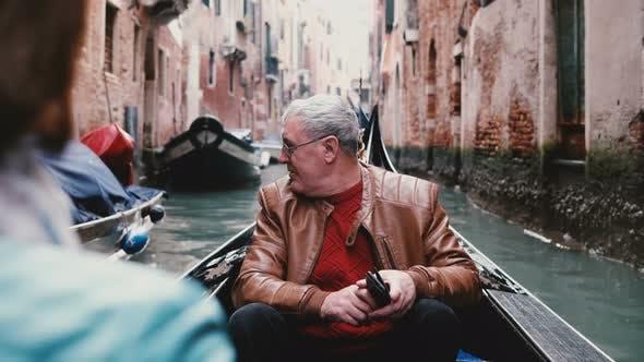 Thumbnail for Happy Senior European Male Traveler in Gondola Excited, Enjoying Venice Canal Tour Excursion on