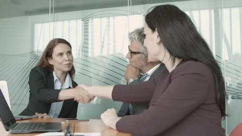 Employers and Job Candidate Shaking Hands