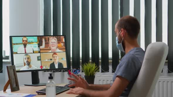 Business Man with Mask Talking on Video Call