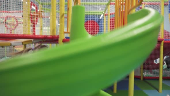 Thumbnail for Girl Moving Down on Slide in Children's Play Center