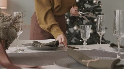 Specialist Arranging Cutlery for Christmas Dinner