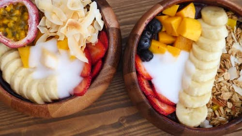 Closeup Of Smoothie Bowl With Granola, Fruits And Berries