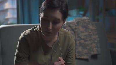 Portrait of a Sad Military Woman
