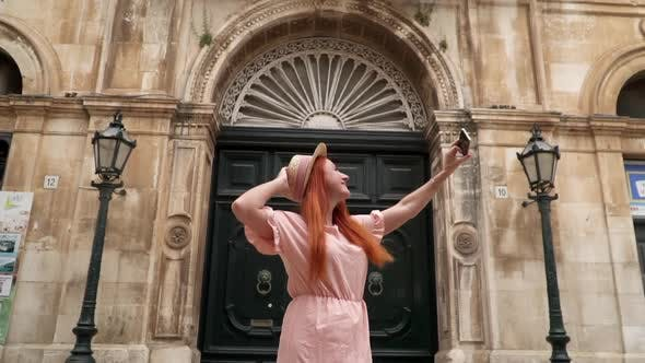 Happy Woman Tourist Takes Selfie on Streets of Old City Italy Puglia