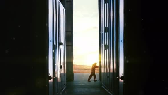 Thumbnail for Opening Door of a Container Warehouse at Sunset.