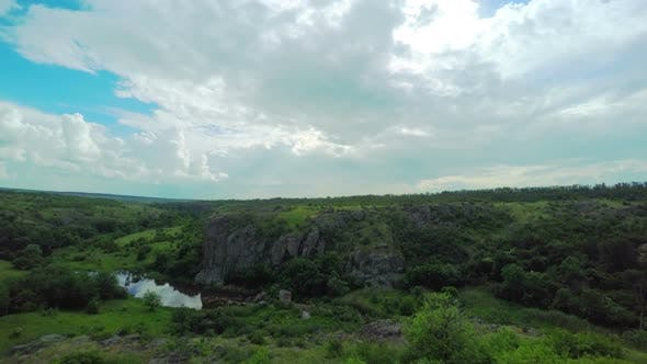 Thumbnail for White Fluffy Clouds over the Canyon
