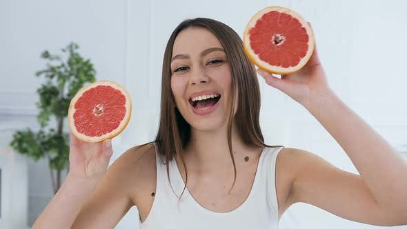 Thumbnail for Beautiful Young Woman with Grapefruit on Eyes.