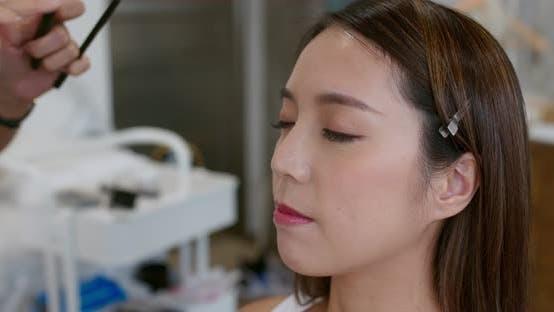Thumbnail for Female model make up in beauty salon