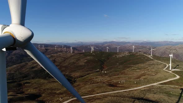 Cover Image for Aerial of Windmills or Wind Turbine on Wind Farm