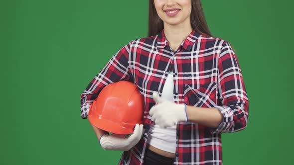 Thumbnail for Cropped Shot of a Smiling Female Engineer Showing Thimbs Up Holding Hardhat