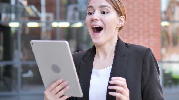 Thumbnail for Young Businesswoman Cheering for Success on Tablet Outdoor