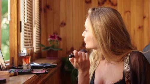 Girl Woman Makes Make-up in the Morning