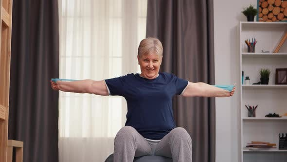 Thumbnail for Old Retired Woman Exercising