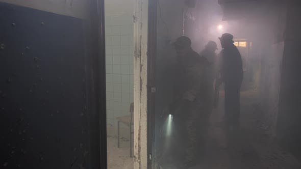 Soldiers Throwing Granade Into Enemy-occupied Room