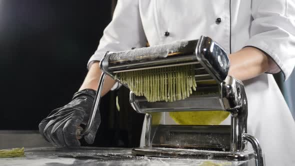 Thumbnail for Traditional Italian Cuisine. Making Pasta on Machine for Cutting Pasta. Slow Motion. Dough Slicing