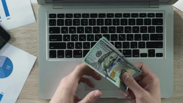 Thumbnail for Businessman's Hands Counting Dollars, Confidence in Future, Importance of Money