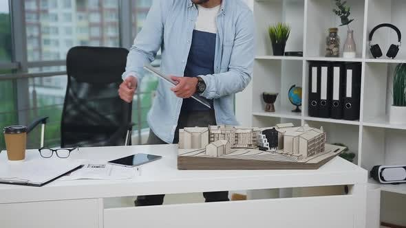 Thumbnail for Professional Bearded 30-Aged Architect Working with Mock-up of Future Building