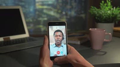 Video Call to the Black Business Partner on Smartphone