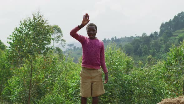 Thumbnail for African child waving hand