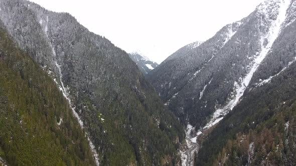 Thumbnail for Fly Over a Magnificent First Snowy Wooded Valley