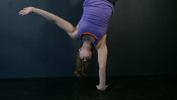 Thumbnail for Fitness Girl Doing Gymnastic Exercises at Fitness Gym. Young Woman Exercising Fitness