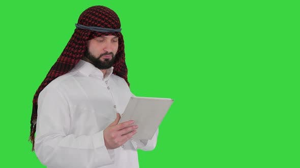Arabic Business Man with Tablet on a Green Screen, Chroma Key.