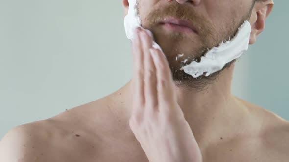 Thumbnail for Man Applying Shaving Foam on Face Skin, Skincare and Hygiene, Morning Ritual