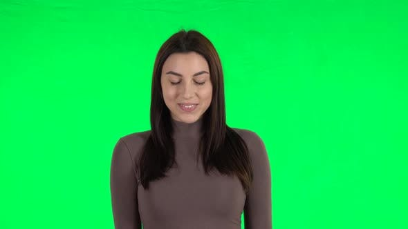 Thumbnail for Attractive Girl Smiling While Looking at Camera. Green Screen