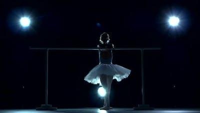 Ballet Dancer in White Tutu on a Blue