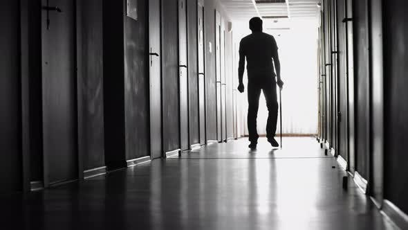 Thumbnail for Male Patient Limping along Hospital Hallway