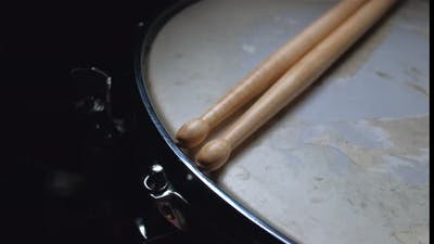 Drumstick Lying on a Drum Snare Close Up.