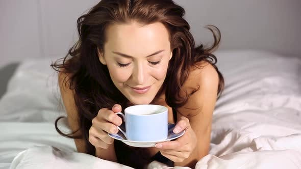 Thumbnail for Woman drinking coffee in bed