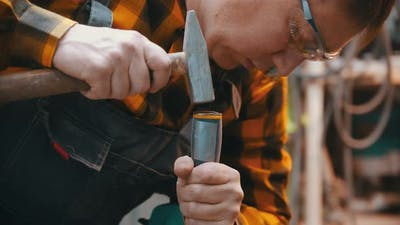 Man Woodworker Making Notches on wood