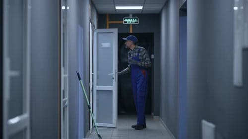 Janitor Checking Rooms in Building