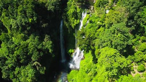 Exotic Waterfall and Beautiful Rainbow