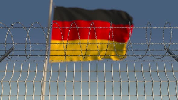 Thumbnail for Blurred Waving Flag of Germany Behind Barbed Wire