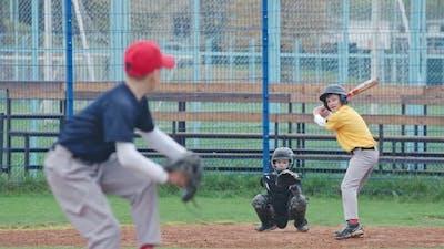 Baseball Tournament at School, Boys Play Baseball, the Pitcher Throws the Ball Toward a Batter