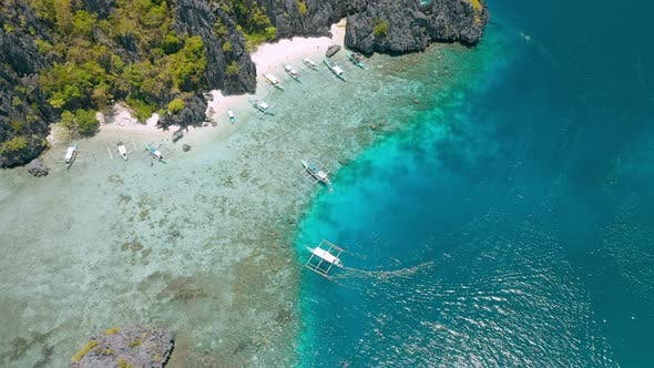 Thumbnail for Tourist Tour Trip Banca Boats in Shallow Water at Shimizu Island in El Nido, Palawan, Philippines
