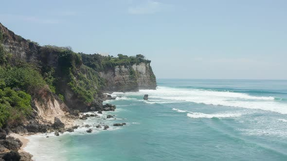 Wild Steep Rocky Cliffs and Blue Ocean in Bali Indonesia