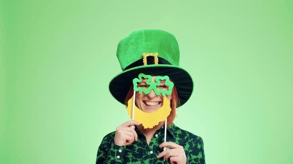 Playful woman in leprechaun costume