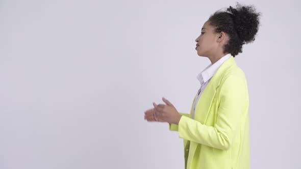 Thumbnail for Profile View of Young Beautiful African Businesswoman Talking