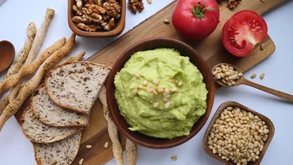 Thumbnail for Guacamole Avocado Sauce And Fresh Bread On Table