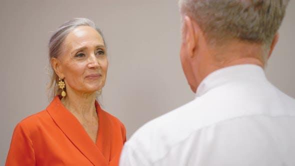 Thumbnail for Senior Couple Talking and Hugging. Mature Woman Embracing Husband and Smiling