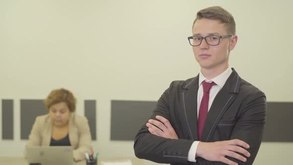 Thumbnail for Portrait of a Attractive Confident Young Man in Glasses and a Beautiful Suit Looking in the Camera